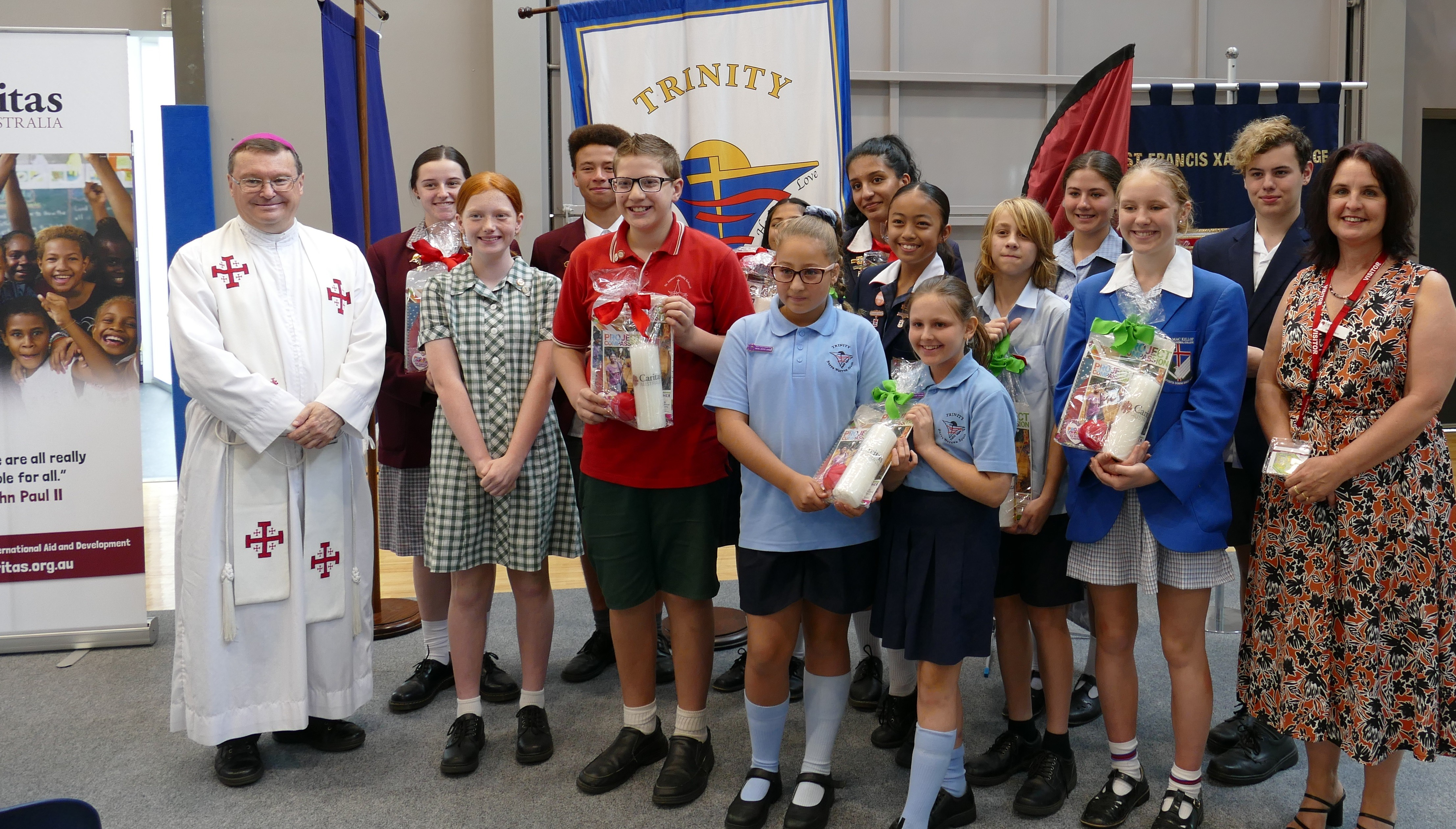 Students with Bishop Pat Project Compassion Launch